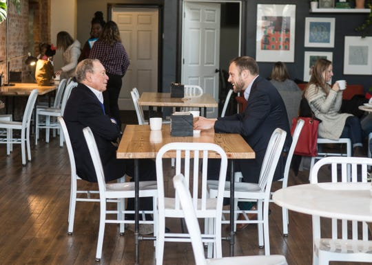Democratic presidential candidate Michael Bloomberg talks with Chillicothe Mayor Luke Feeney about the efforts taken to revitalize Downtown Chillicothe even amid the rampant opioid issues that still plague Chillicothe and other parts of Ohio on Dec. 20, 2019.