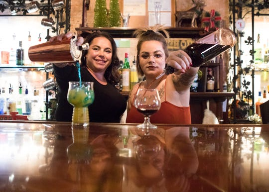 (L-R) Local bartenders Tara Gillum and Kelsey Smith participated in a cocktail competition  and won fan favorite for their beverage.