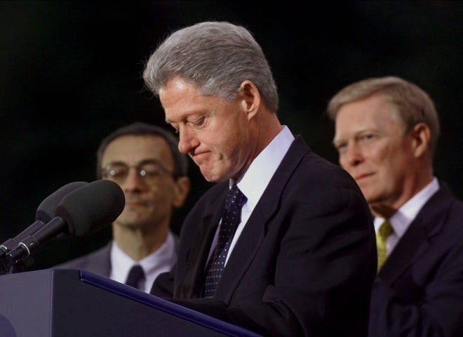 Dec. 19, 1998: Backed up by House Minority Leader Richard Gephardt, D-Mo., right, President Clinton prepares to speak outside the Oval Office at the White House following the historic impeachment vote by the House of Representatives. House Democrats came to the White House after the vote as a show of support for the embattled chief executive. White House Chief of Staff John Podesta stands at left.