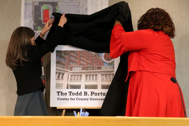 Hamilton County Commission President Denise Driehaus, and Hamilton County Commissioner Stephanie Dumas, right, reveal the new name for the county administration building, the Todd B. Portune Center for County Government, Thursday, Dec. 19, 2019, in Cincinnati.