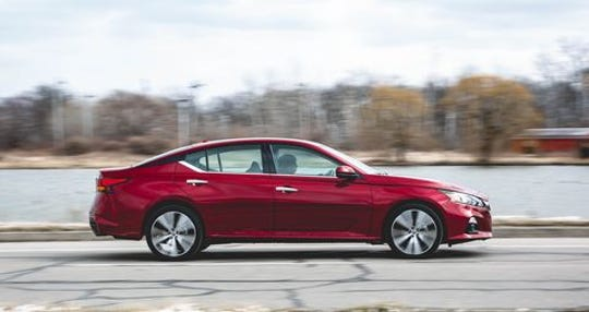 A red 2019 Nissan Altima similar to the one police are searching for.