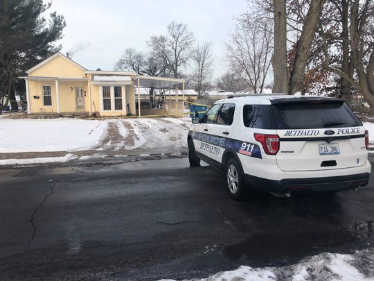 Bethalto, Illinois, Police respond to a home where three people were found dead Thursday night, Dec. 20, 2019.