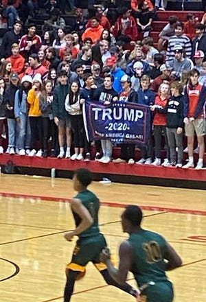 Students displaying a Trump banner during a basketball game between Rossview High School and Northwest High School on Dec. 19, 2019.