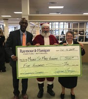 Patrick Carter, Raymour & Flanigan Watchung store manager; S. Lisa D. Gambacorto, RSM, Ed.S., Mount Saint Mary Academy directress; and Michael Fontana, Mount Saint Mary Academy parent, as Santa Claus.