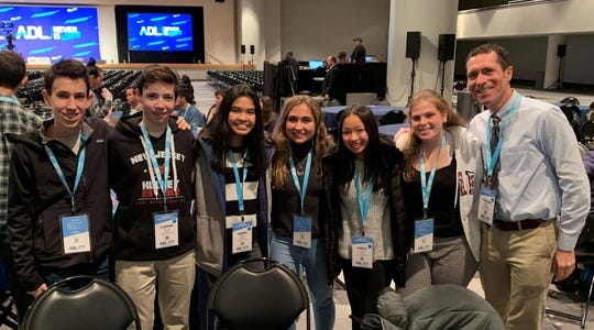 "(Left to right) Aidan Berman, Cooper Harris, Karen Abaya, Anastasia Fowler, Grace Sacco, Roselyne Garabete, and WHS Assistant Principal Warren Hynes attended the ADL ""Never is Now"" Summit in New York City on Thursday, Nov. 21."