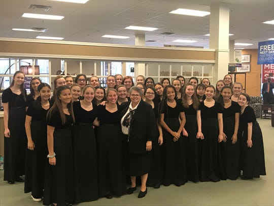S. Lisa D. Gambacorto, RSM, Ed.S., Mount Saint Mary Academy Directress; with members of the academy's two vocal ensembles: Chorale and GraceNotes.