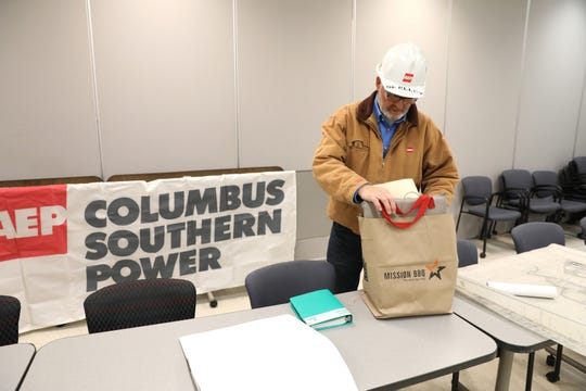 Former plant manager Erich Skelley unpacks a bag of memorabilia from AEP's Conesville Generating Station. Skelley and other employees are gathering items to donate to the Johnson-Humrickhouse Museum in Roscoe Village to help residents remember the plant.