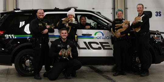 Norwalk Police officers pose with cats rescued by Whiskers TNR. (From left) Sgt. Trevor Martin, officers Jack Haller, Lilly Dunlop, Brad Criswell, Kirstin Koestler, and chief Greg Staples.