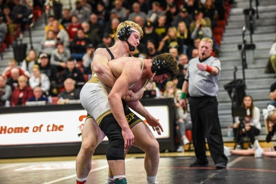 Southeast Polk's Gabe Christenson lifts Fort Dodge's Levi Egli during a match on Thursday night. Christenson beat Egli, 11-3, at 195 pounds, and the Rams beat the Dodgers, 37-19.