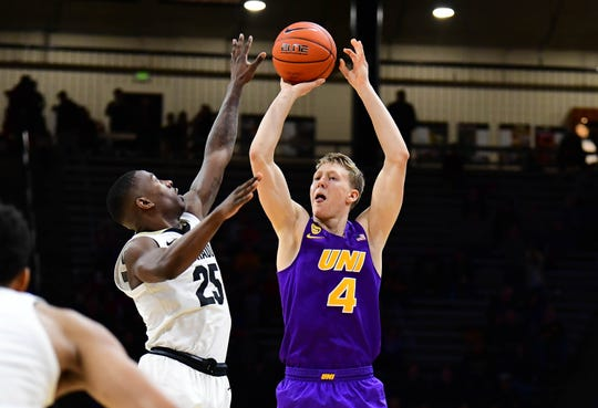Dec 10, 2019; Boulder, CO, USA; Northern Iowa Panthers guard AJ Green (4) attempts over Colorado Buffaloes guard McKinley Wright IV (25) n the second half at the CU Events Center.