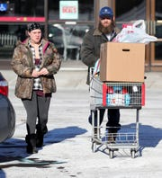 Rebecca and Robert Plessinger walk to their car after shopping at the last standing Kmart store in Marshall Mich. Thursday, December 19, 2019 in Marshall Mich.
