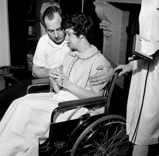 In this April 30, 1964 file photo, Dora Fronczak holds a rosary as she and her husband Chester Fronczak pray for the return of their kidnapped son in Chicago.