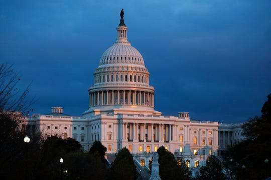 FILE - In this Tuesday, Nov. 12, 2019, file photo, the U.S. Capitol is seen as the sun sets in Washington.
