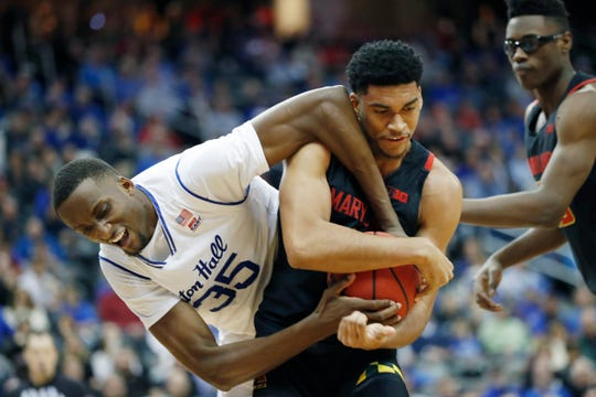Seton Hall center Romaro Gill (35) and Maryland forward Ricky Lindo Jr. (4) struggle for control of the ball during the second half on Thursday.
