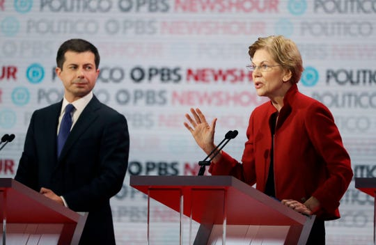Democratic presidential candidate Sen. Elizabeth Warren, D-Mass., right, speaks as South Bend Mayor Pete Buttigieg listens during a Democratic presidential primary debate Thursday, Dec. 19, 2019, in Los Angeles.