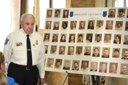 Warren Police Commissioner William Dwyer displays some of the 46 people arrested by the Warren Police Department's Special Investigation Division and Special Operation Unit. The arrest are part of Operation Crusade II which focused on human trafficking prostitution and pandering.