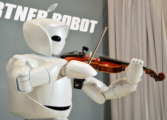 Toyota Motor Corp.'s new violin robot performs during a press unveiling in Tokyo Thursday, Dec. 6, 2007.