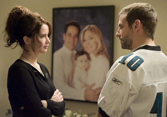 "Jennifer Lawrence and Bradly Cooper in ""Silver Linings Playbook."""