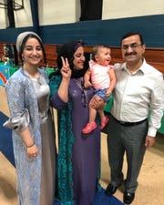 Haimen Al-Sumaidaee, right, and his family are Iraqi refugees who came to Michigan in 2016 and were aided by St. Vincent Catholic Charities.