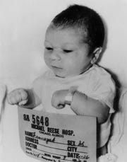 FILE - This April 26, 1964 file photo shows new-born Paul Joseph Fronczak shortly after his birth at Michael Reese Hospital in Chicago. The baby was taken from his mother's arms by a woman dressed as a nurse who told her he needed a medical exam and then never returned him to the nursery.