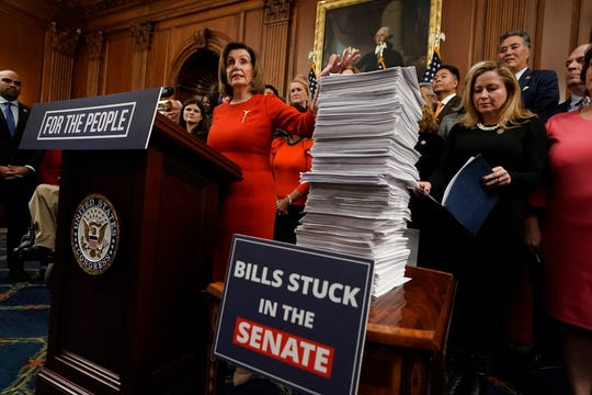 House Speaker Nancy Pelosi, D-Calif., and House Democrats meets with reporters at the Capitol in Washington, Thursday, Dec. 19, 2019, on the day after the House of Representatives voted to impeach President Donald Trump on two charges, abuse of power and obstruction of Congress.