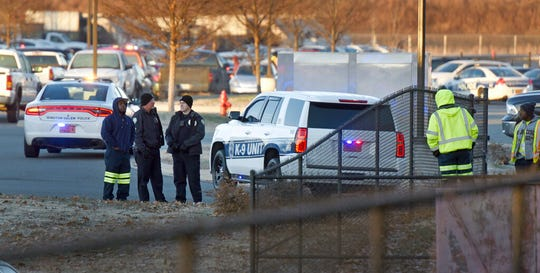 City workers and police stand outside the Joycelyn V. Johnson Municipal Services Center after reports of gunshots in Winston-Salem, N.C. early Friday, Dec. 20, 2019.