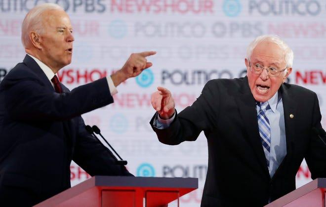 Democratic presidential candidates former Vice President Joe Biden, left, and Sen. Bernie Sanders, I-Vt., speak during a Democratic presidential primary debate Thursday, Dec. 19, 2019, in Los Angeles.