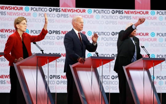 Democratic presidential candidates from left, Sen. Elizabeth Warren, D-Mass., former Vice President Joe Biden and Sen. Bernie Sanders, I-Vt., participate during a Democratic presidential primary debate Thursday, Dec. 19, 2019, in Los Angeles.