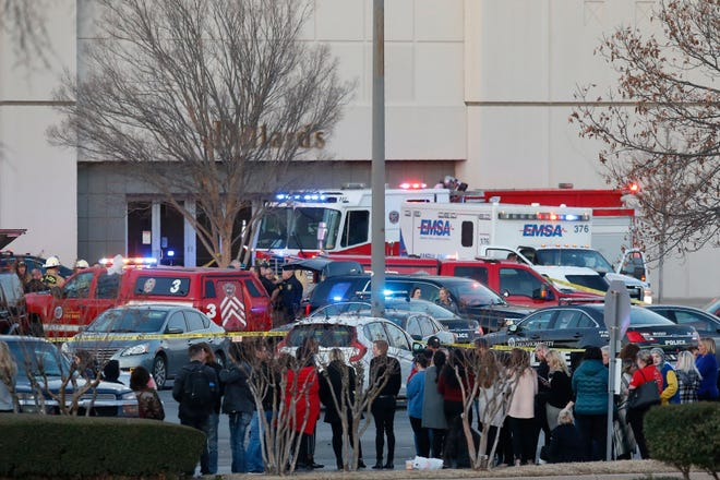Bystanders watch as police clear Penn Square Mall following a shooting Thursday, Dec. 19, 2019, in Oklahoma City. One person was shot at the mall during what police are calling a disturbance involving two people.