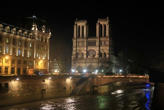 Notre Dame Cathedral is lit up in Paris, Monday, Dec. 16, 2019. The Notre Dame Cathedral has been newly illuminated last month since the April fire in 2019.