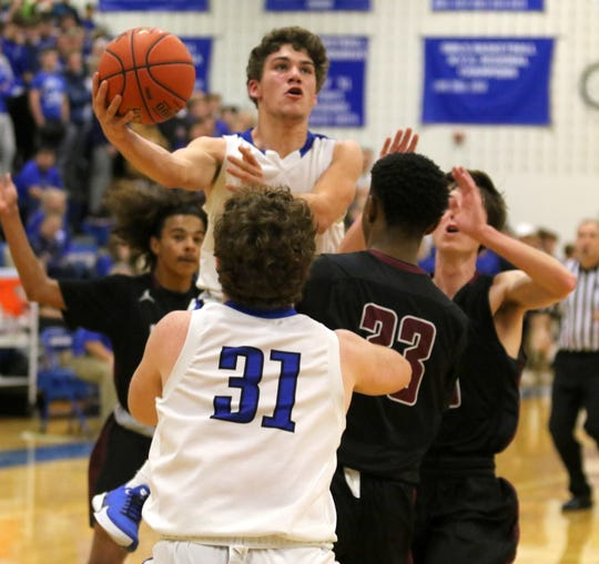 Grayson Woodhouse of Horseheads goes up for a shot against Elmira in boys basketball Dec. 19, 2019 at Horseheads Middle School.