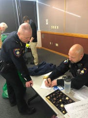 Fond du Lac Police Chief Bill Lamb and Officer Jesse Pimental help organize the Christmas delivery on Friday, Dec. 20 at the Fond du Lac Police Department.