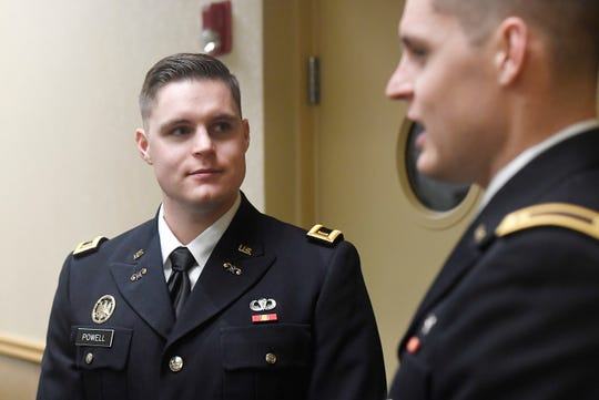 Second lieutenant Jason Powell looks to his twin brother second lieutenant William Powell as they talk to the Coloradoan after their Army Reserve Officers' Training Corps Commissioning Ceremony at Colorado State University in Fort Collins, Colo. on Friday, Dec. 20, 2019.