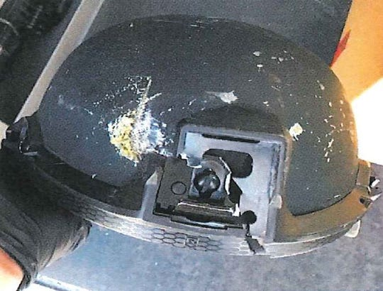 The ballistic helmet of Loveland Police Officer Paul Ashe is pictured, showing the impact of a bullet fired Nov. 11 by Tammy Pierce, who had killed her husband days earlier in their Loveland home.