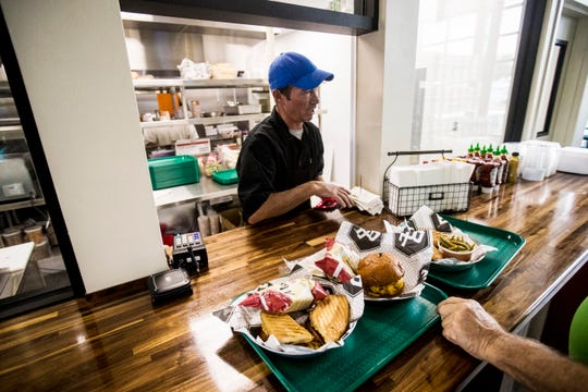 The LaBelle Brewing Co. and Buckingham Farms restaurant recently opened in LaBelle. It is the first brewery to open in Hendry County. Jarrett Spring expedites food.