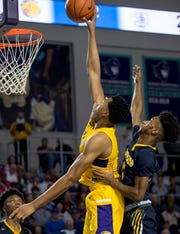 Scottie Barnes of Montverde Academy tips in a shot in front of Nasir Cowan of Sanford School in the 2019 City of Palms Classic on Thursday, Dec. 19, 2019, at Suncoast Credit Union Arena in Fort Myers.
