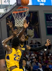 Day'ron Sharpe of Montverde Academy takes a shot as Nnanna Njoku of Sanford School tries for a block in the 2019 City of Palms Classic on Thursday, Dec. 19, 2019, at Suncoast Credit Union Arena in Fort Myers.