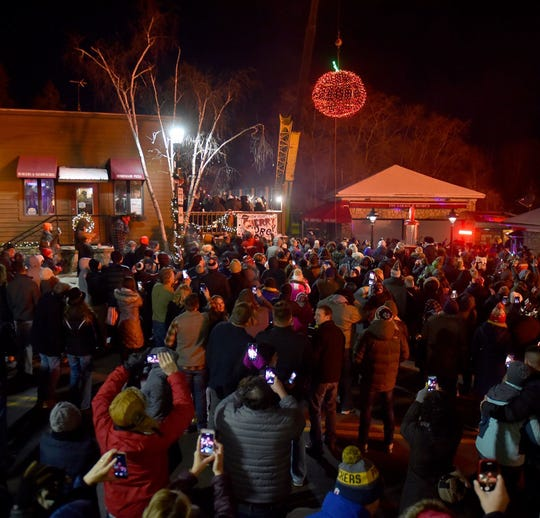 Crowds gather to watch The Lodge Cherry Drop to count down to the new year in Sister Bay.