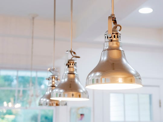Light fixtures hanging from the ceiling in the kitchen.