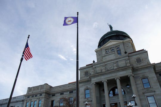 The Little Shell tribal flag flies in front of the state capitol building, celebrating the 127 years the tribe has awaited federal recognition.