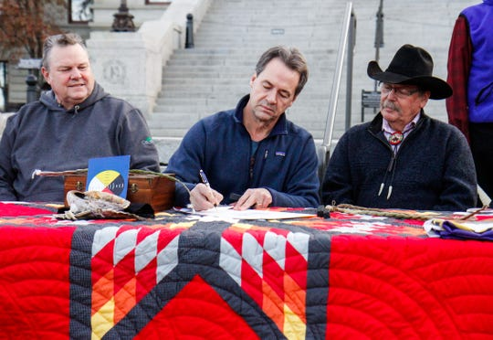 Gov. Steve Bullock signs a proclamation Friday honoring the Little Shell being federally recognized.
