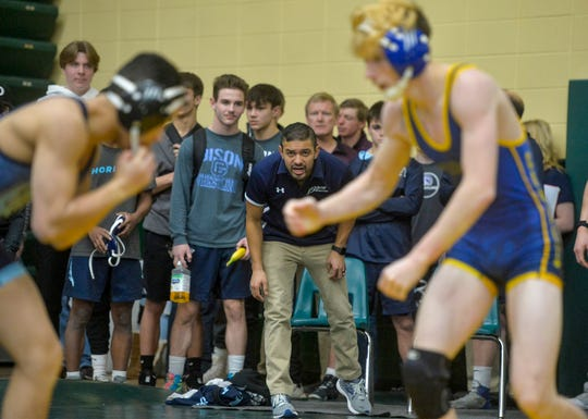 Great Falls High's head wrestling coach Luis Carranza yells instructions to his wrestler on the mat during the C.M. Russell Hoilday Classic wrestling tournament on Friday in the CMR Fieldhouse.