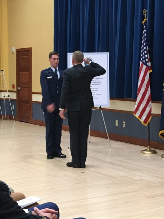 Second Lieutenant Will Early accepts his first salute as an officer in the Air Force from his uncle, Mark Schmidt, a retired Marine Corporal.