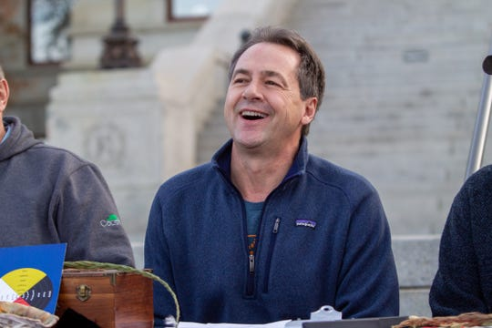 Gov. Steve Bullock smiles before signing a proclamation celebrating the federal recognition of the Little Shell tribe.