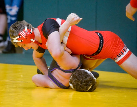 Glasgow's Dylan Nieskens attempts to pin Laurel's Donald Maurer during the C.M. Russell Hoilday Classic wrestling tournament on Friday in the CMR Fieldhouse.
