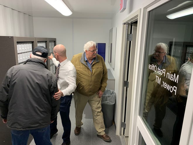 Manager of Post Office Operations Hal Barber in white shows a resident of Power the new post office facility that is set to open on Friday, Dec. 20, 2019, just in time for the holidays.