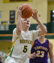 CMR's Tucker Harrison goes up for an uncontested layup in Thursday's basketball game against Missoula Sentinel.