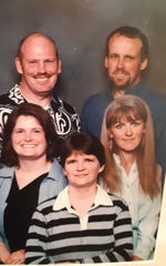 Cheryl Larsen sits, center right, surrounded by family. In the back row are brothers Richard Peplinski, left, and Stanley Peplinski. Next to Cheryl are sisters Ann Rambo, left and Deborah Blatter.