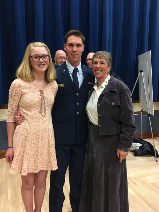 Second Lieutenant Will Early stands tall with his sister, Abby Hutton, and his proud mom, Lisa Schmidt.