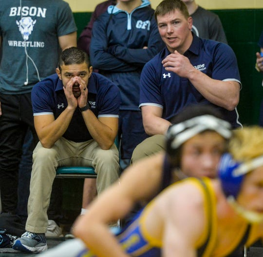 Great Falls High's head wrestling coach Luis Carranza, left, yells instructions at a tournament earlier this season. The Bison and C.M. Russell High are set to compete in the 15-team AA Duals at Great Falls High on Saturday.